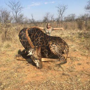 Tess Talley poses with 'rare' giraffe